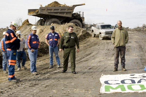 West Virginia State Trooper Sgt. Smith arrests Mike Roselle for laying down in the road with a banner on Massey Energy owned Edwight mountaintop removal coal mine site, Febraury 25, 2009, exactly 37 years after the Buffalo Creek disaster in Man, WVa.