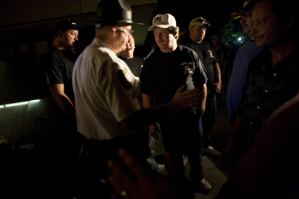 West Virginia Capitol Police escorted six coal miners from the Capitol Complex after they became hostile and threatening towards those who tried to talk to them after the screening.  photograph (c) antrim caskey, 2009