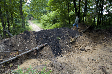 The last of six man made berms blocking Cook Mountain Road and access to three separate Cook family cemetery sites which holds a grave of Civil War soldier, William Chapman Cook.  photograph (c) antrim caskey, 2009