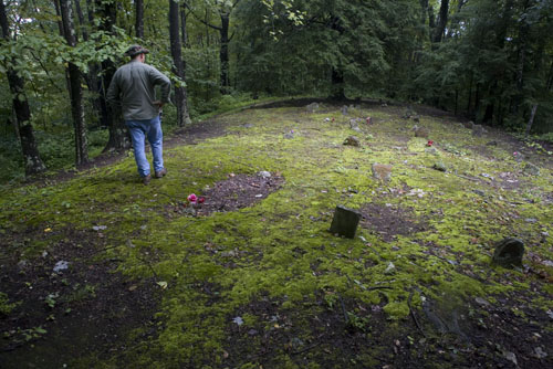 Marvin White inspects the largest of three Cook family cemeteries on Cook Mountain, Thursday, July 30, 2009.  photograph (c) antrim caskey, 2009