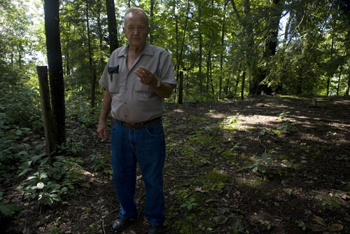 Leo Cook, 73, standing in the largest of three Cook family cemeteries on Cook Mountain, grew up here and has worked to maintain the historic cemeteries over the years.  antrim caskey (c) 2009